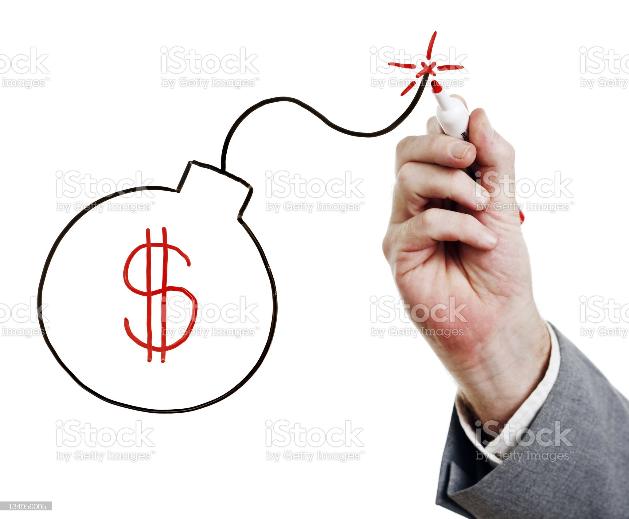 Businessman's hand draws bomb containing dollar sign on whiteboard royalty-free stock photo