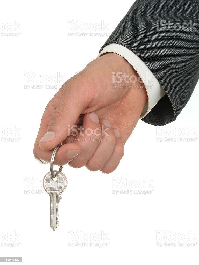 Businessman's Hand Holding Key royalty-free stock photo