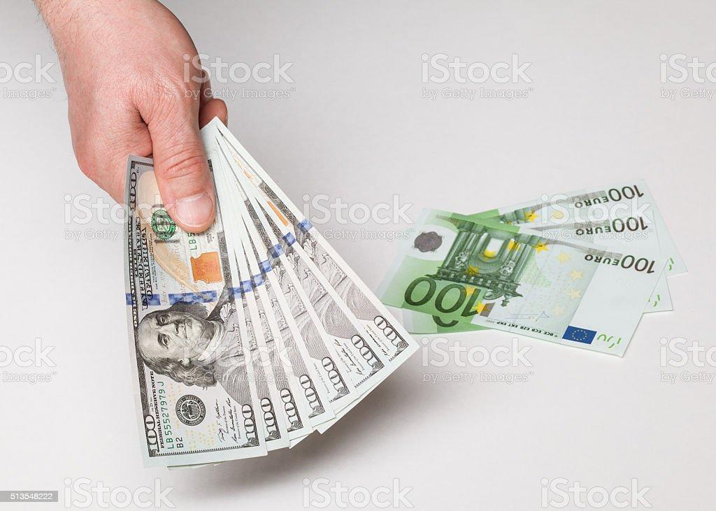 Businessman's hand holding many dollars stock photo
