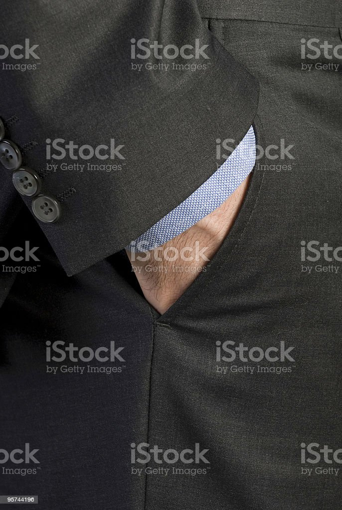 Businessman's hand in pocket royalty-free stock photo