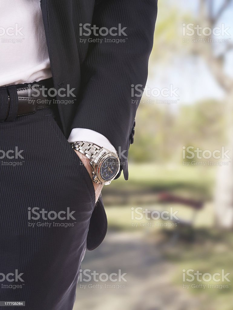 Businessman's hand in the pocket with wristwatch. royalty-free stock photo