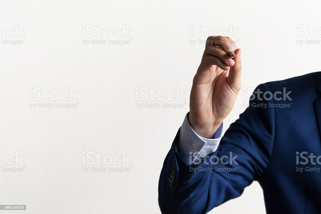 Businessman's hand on writing and drawing stance stock photo