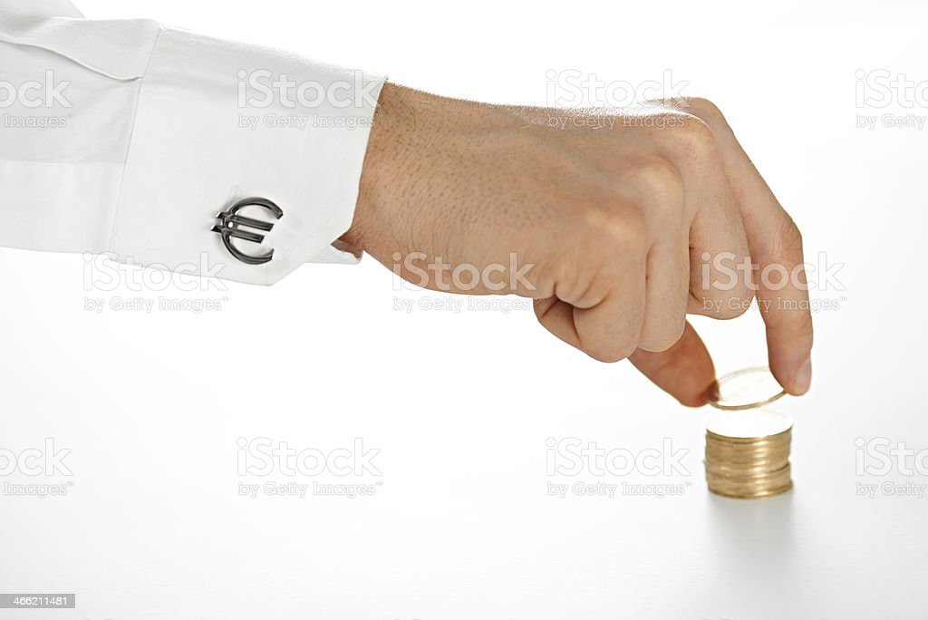 Businessman's Hand Placing Coins stock photo