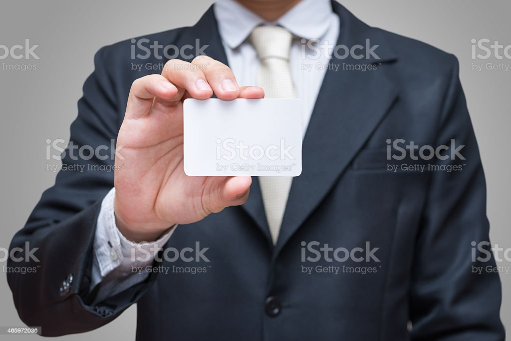 Businessman's hand showing business card isolated stock photo