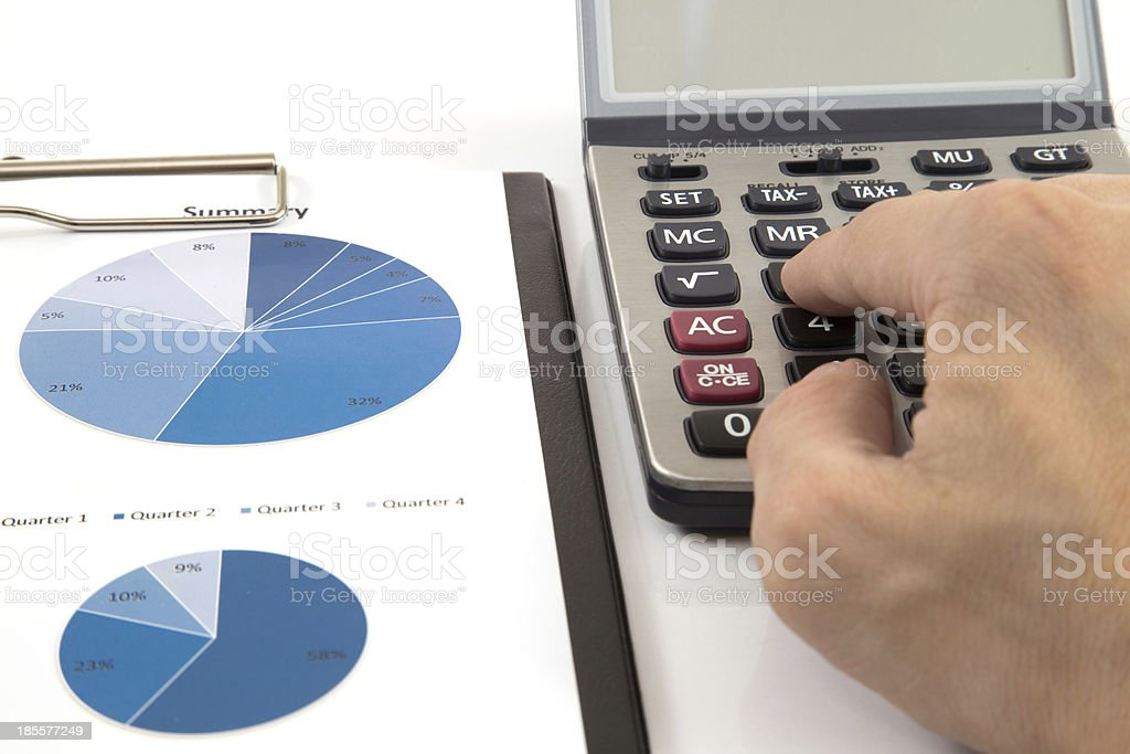 Businessman's hand showing diagram on financial report royalty-free stock photo