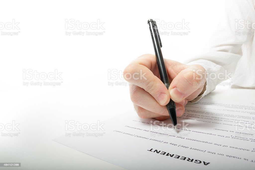 Businessman's hand signing papers. Lawyer, realtor, businessman stock photo