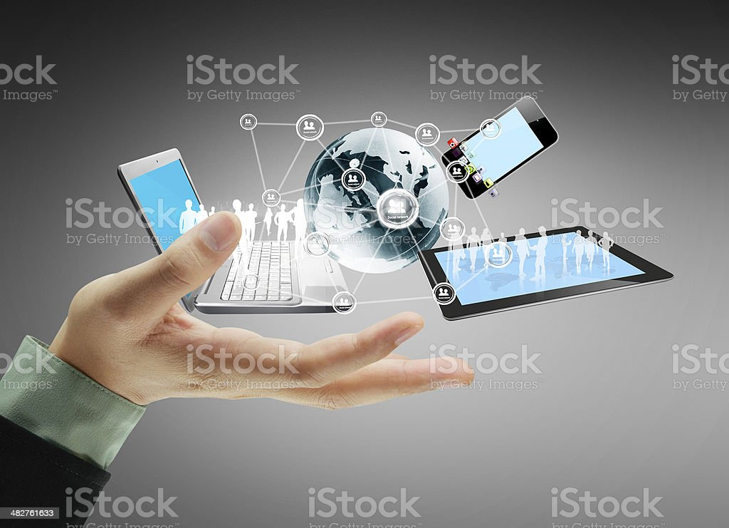 Businessman's hand with floating technology icons stock photo