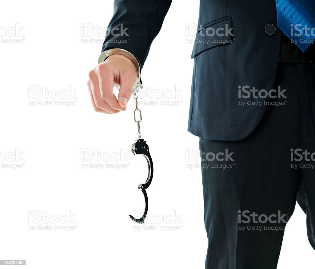 Businessman's hand with handcuffs stock photo
