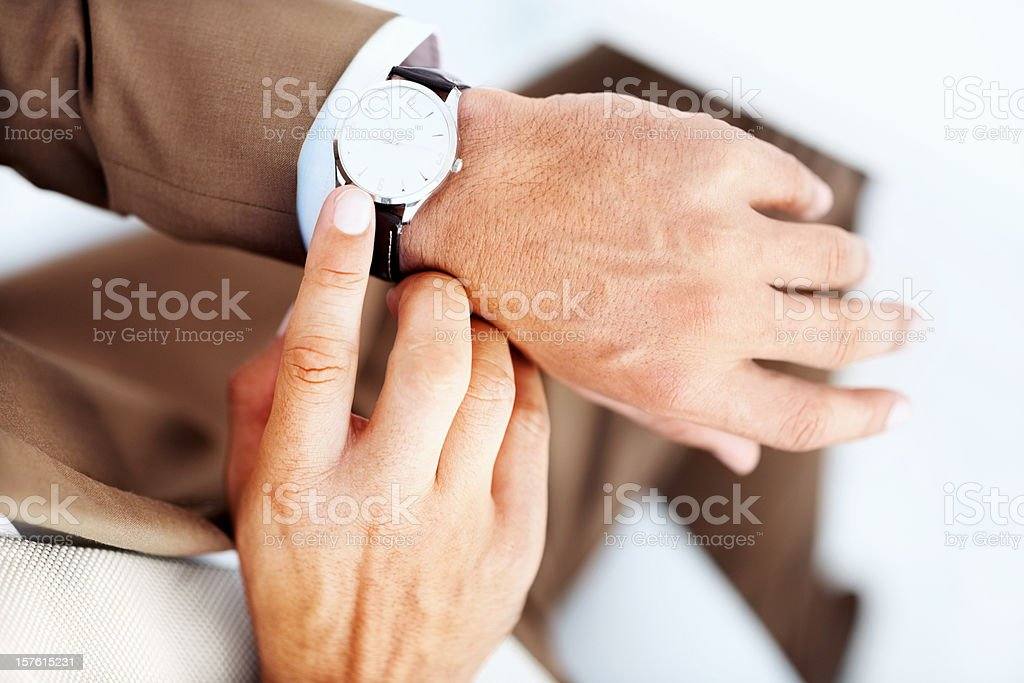 Businessman's hand with wrist watch royalty-free stock photo