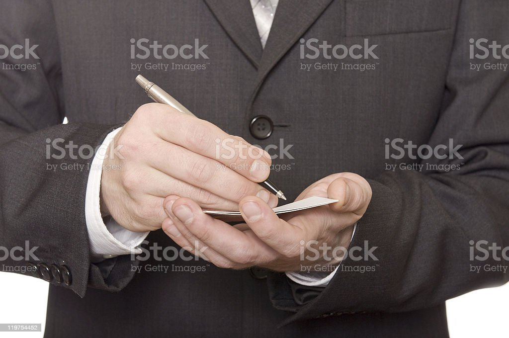 businessman's hand writing in the business card royalty-free stock photo