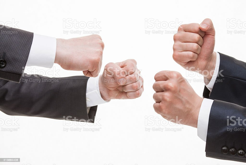 Businessman's hands demonstrating a gesture of a strife stock photo