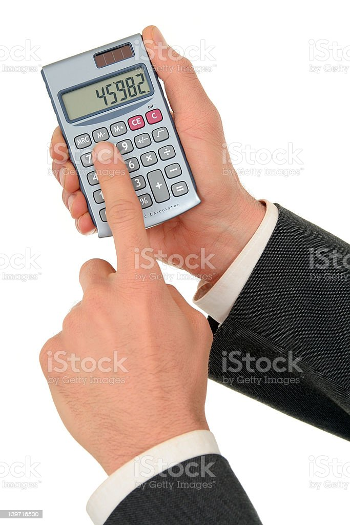 Businessman's Hands Holding a Calculator royalty-free stock photo