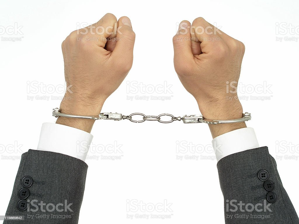 Businessman's Hands In Handcuffs royalty-free stock photo