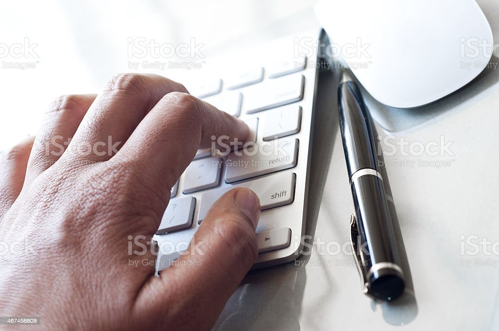 Businessman's hands typing on computer keyboard royalty-free stock photo