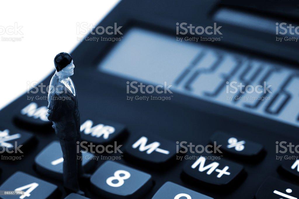 Businessmans on calculator stock photo