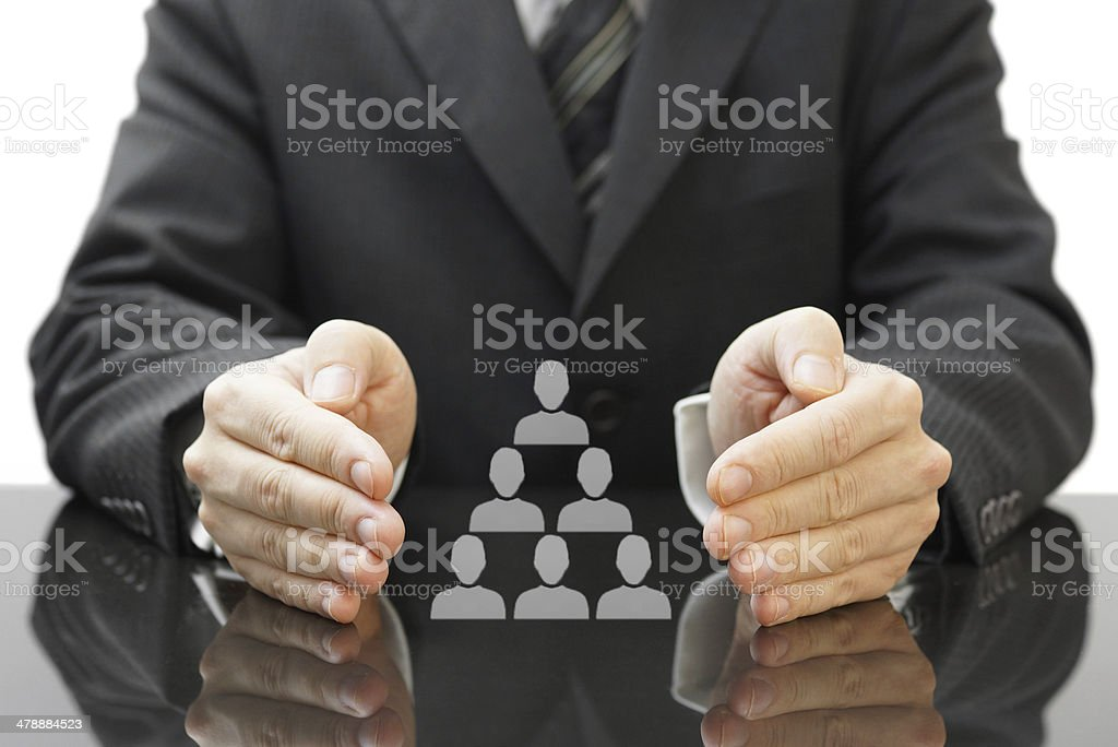 businessman's protecting  employees in his company stock photo