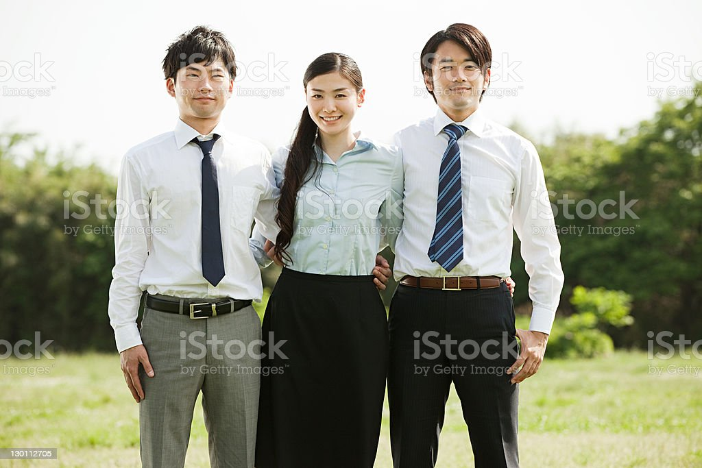 Businessmen and businesswoman, portrait stock photo