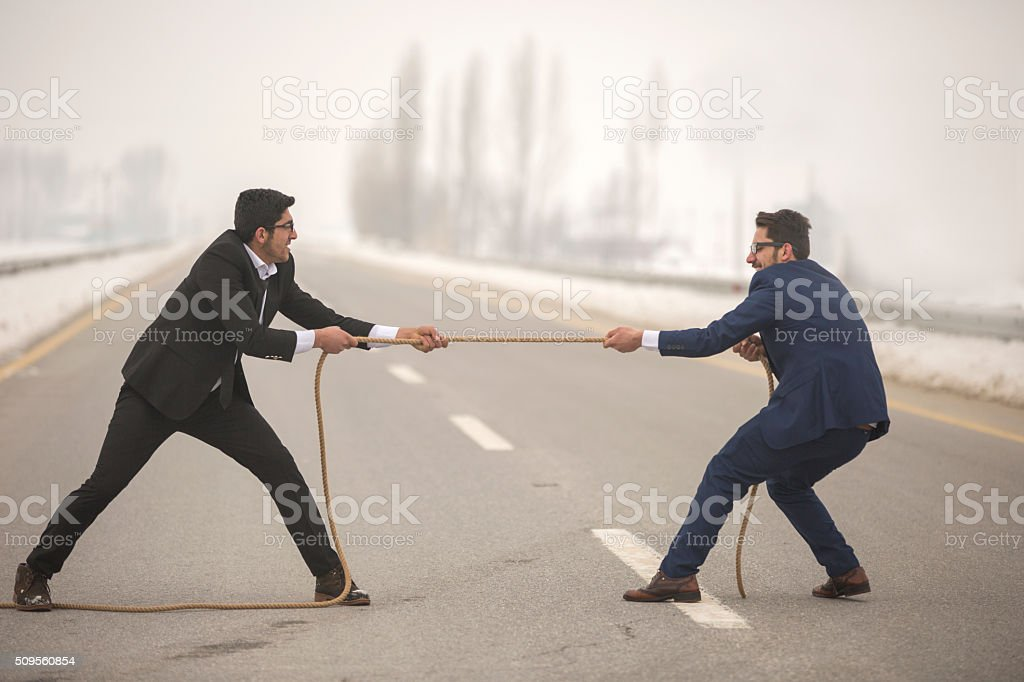 Businessmen and confrontation stock photo