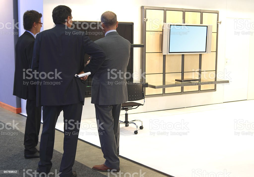 Businessmen and Modern LCD TV royalty-free stock photo