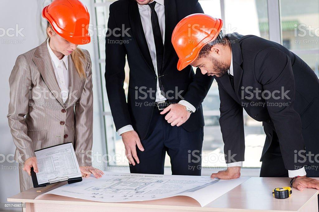 Businessmen Architects solve problems. Three businessman archite stock photo