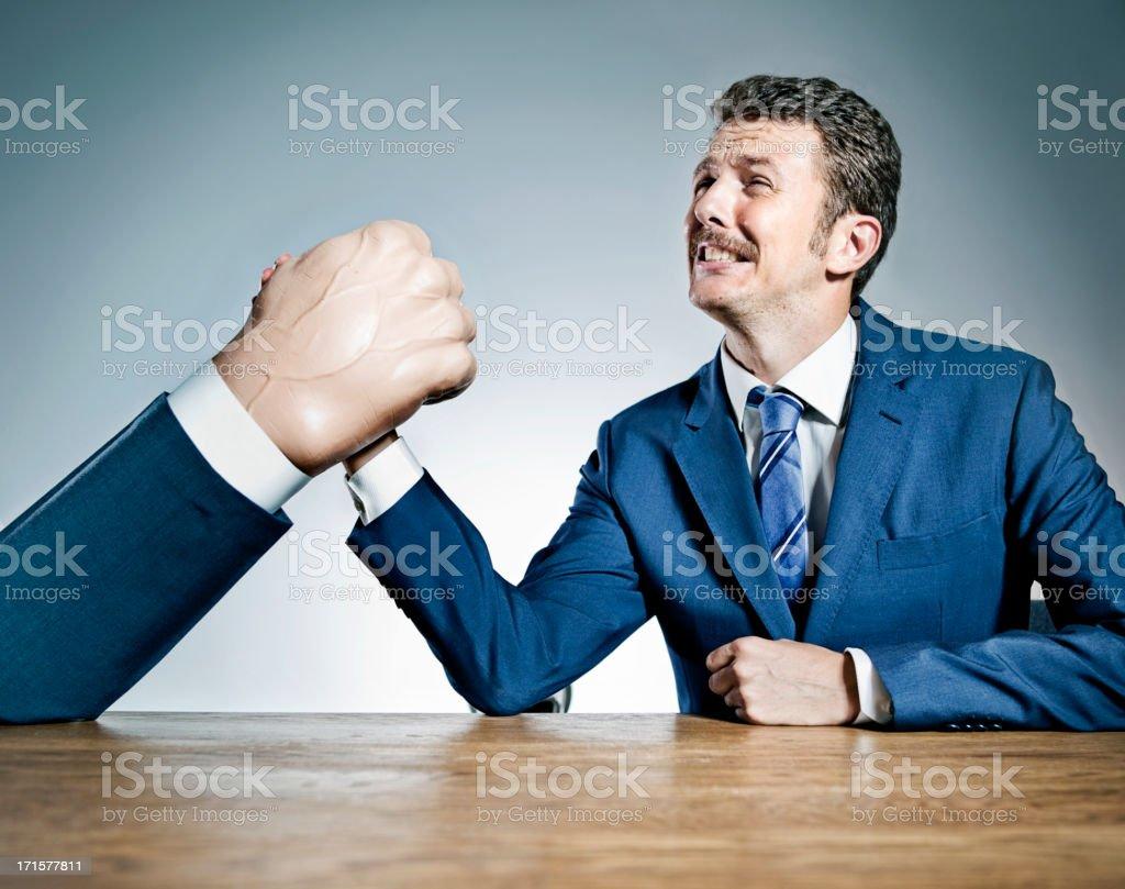 Businessmen arm wrestling stock photo