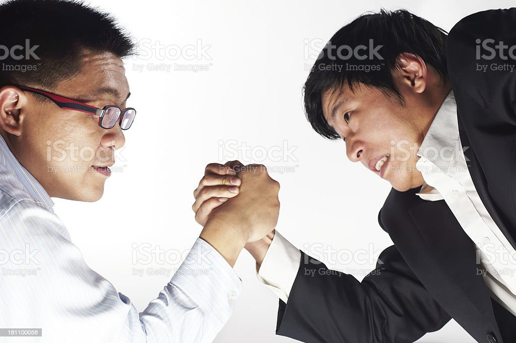 Businessmen Arm Wrestling royalty-free stock photo