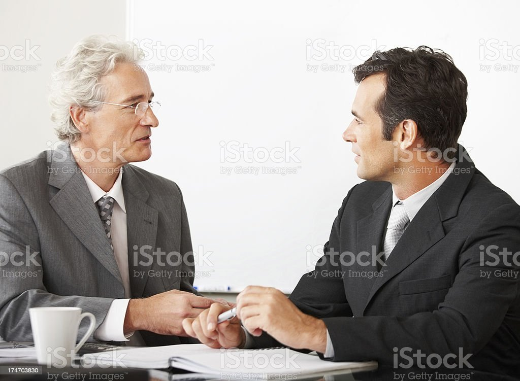 Businessmen at a meeting royalty-free stock photo