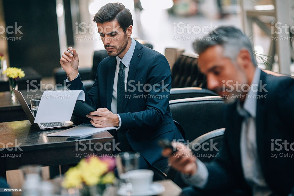 Businessmen at an internet cafe stock photo