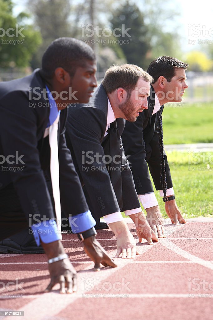 Businessmen at starting line of race stock photo