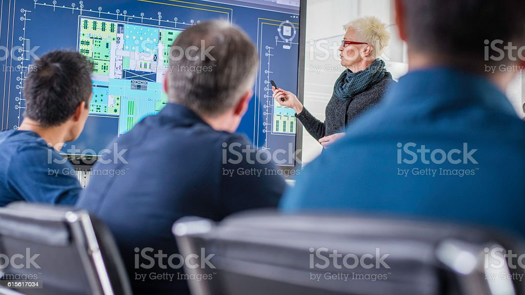 Businessmen attending an architecture seminar stock photo