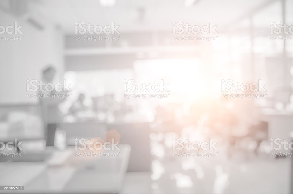 Businessmen blur in the workplace.Table Top And Blur Office . stock photo