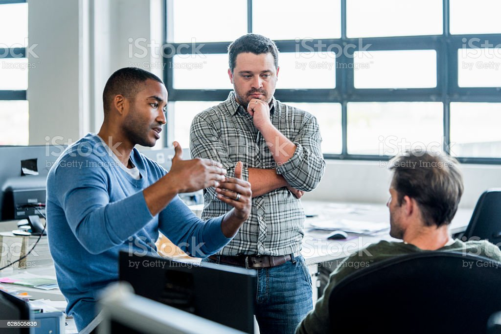 Businessmen discussing in creative office stock photo