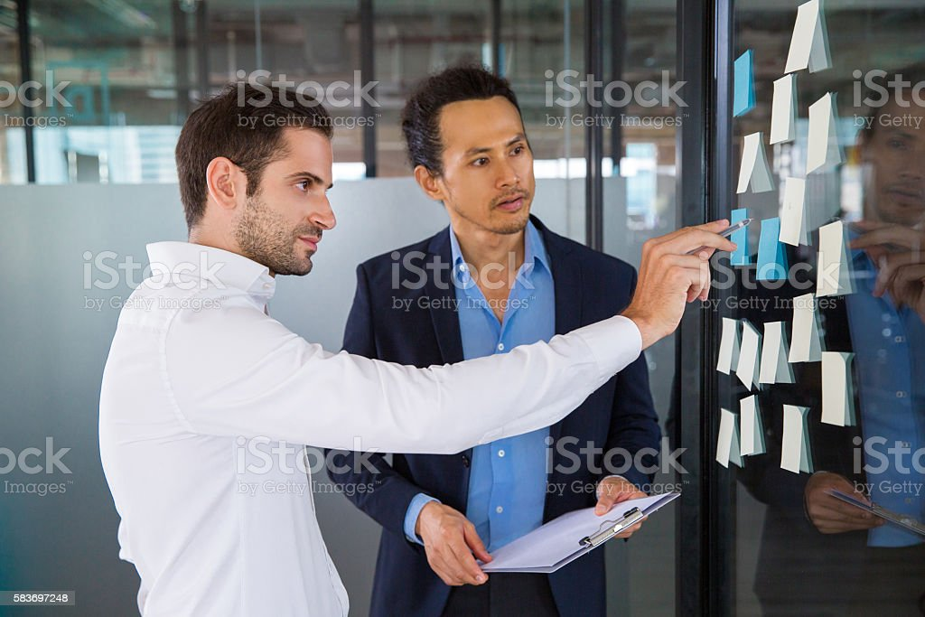 Businessmen Discussing Issues in Office stock photo