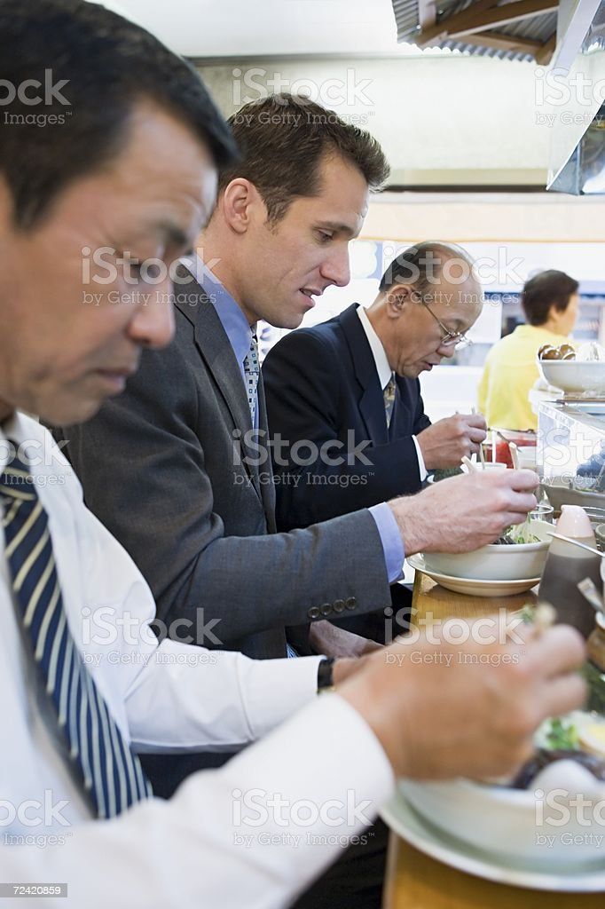 Businessmen eating royalty-free stock photo
