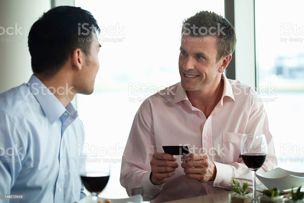 Businessmen exchanging business cards stock photo
