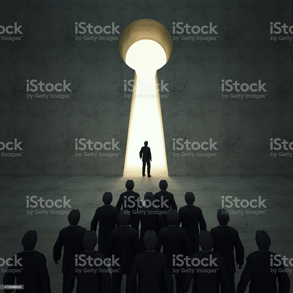 Businessmen front of key hole door concept. stock photo