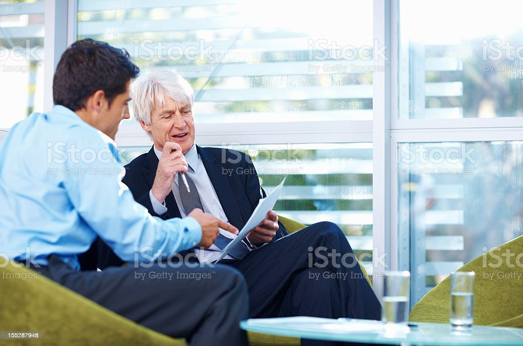Businessmen going over some documentation royalty-free stock photo