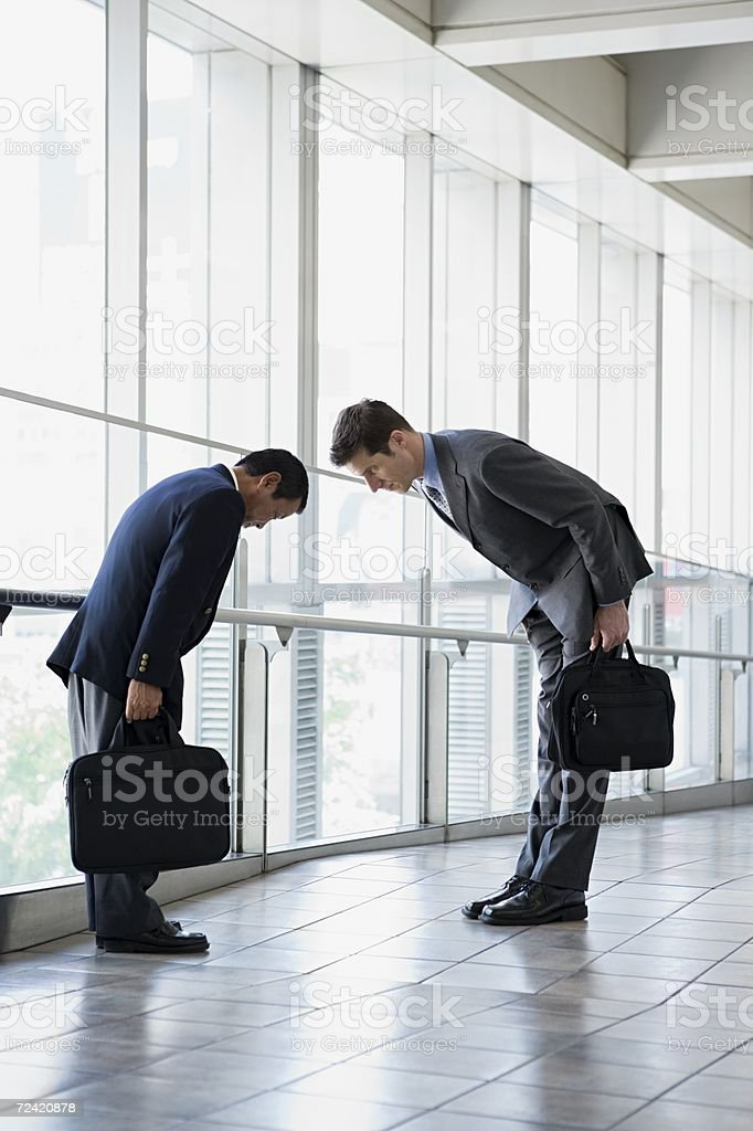 Businessmen greeting stock photo