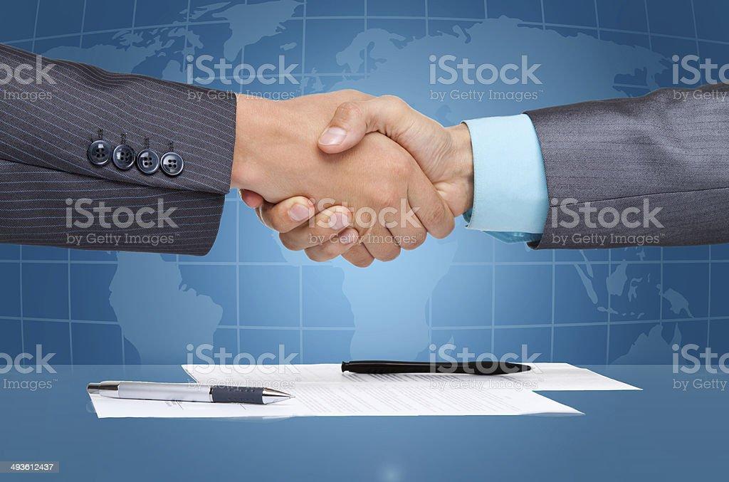 Businessmen hand shake stock photo