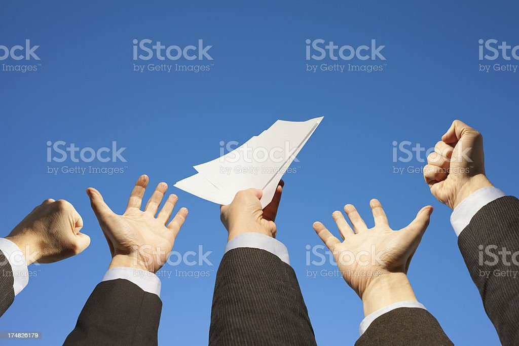 Businessmen hands raising up to the sky, holding documents royalty-free stock photo