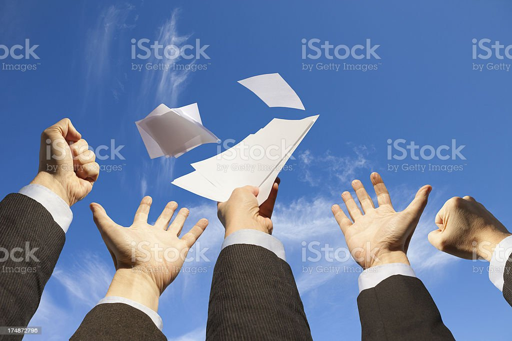 Businessmen hands raising up to the sky, launching documents royalty-free stock photo
