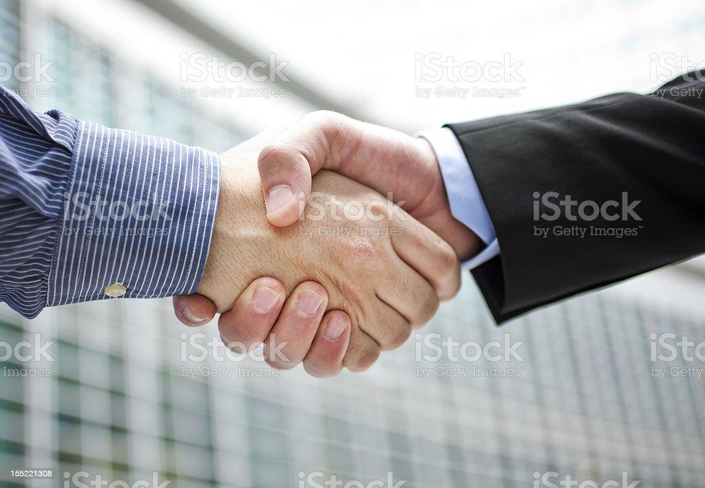 Businessmen handshake royalty-free stock photo