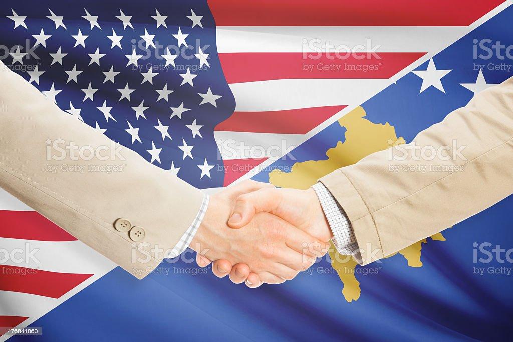 Businessmen handshake - United States and Kosovo stock photo