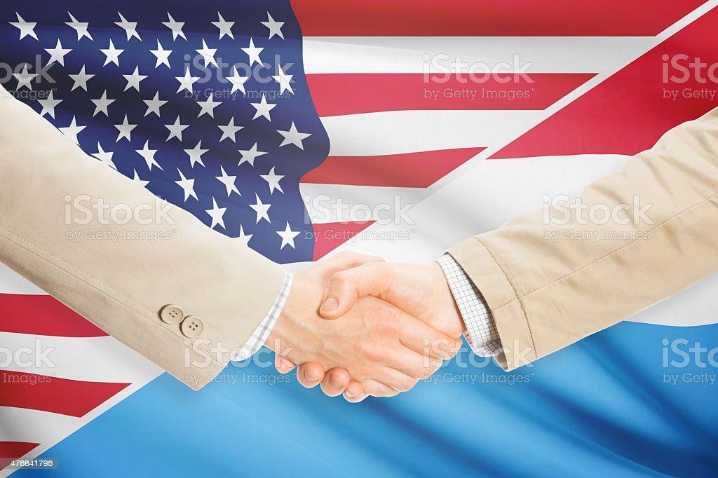 Businessmen handshake - United States and Luxembourg stock photo