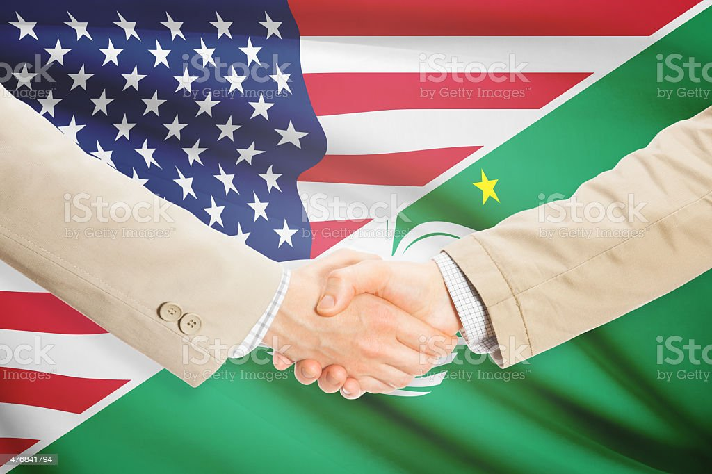Businessmen handshake - United States and Macau stock photo