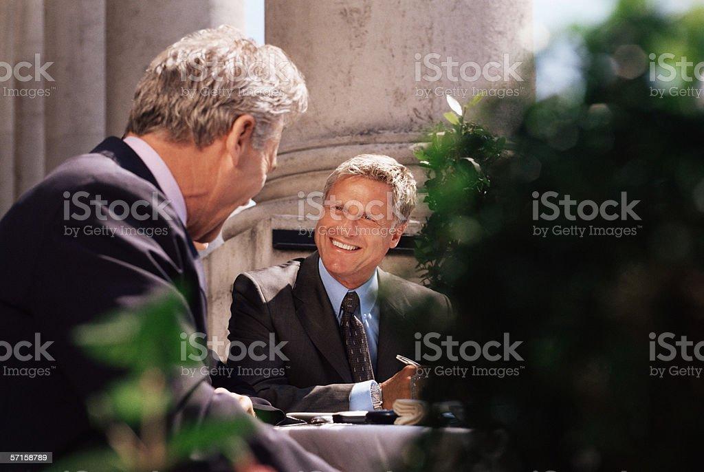Businessmen having a meeting stock photo