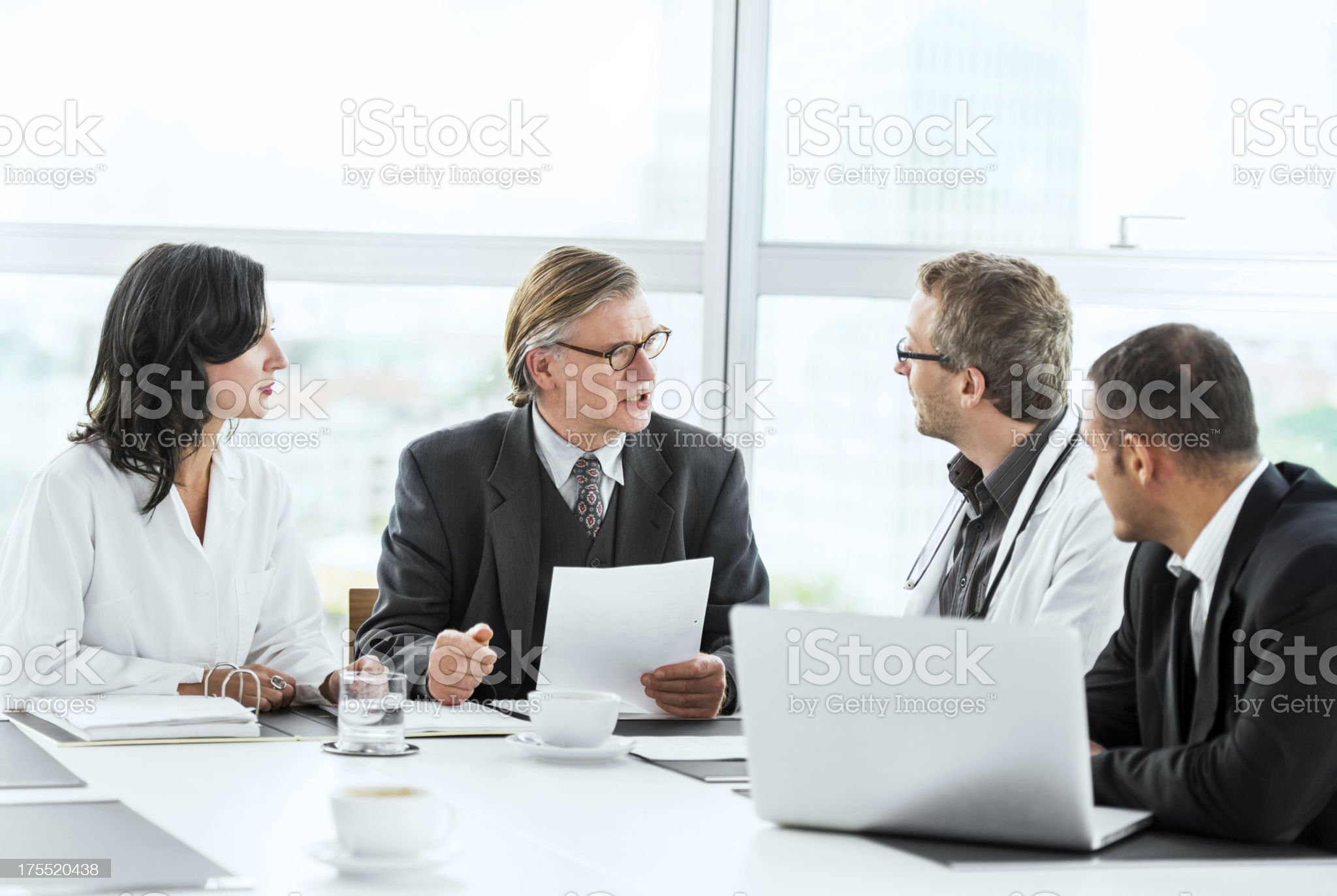 Businessmen having a meeting with doctors. royalty-free stock photo