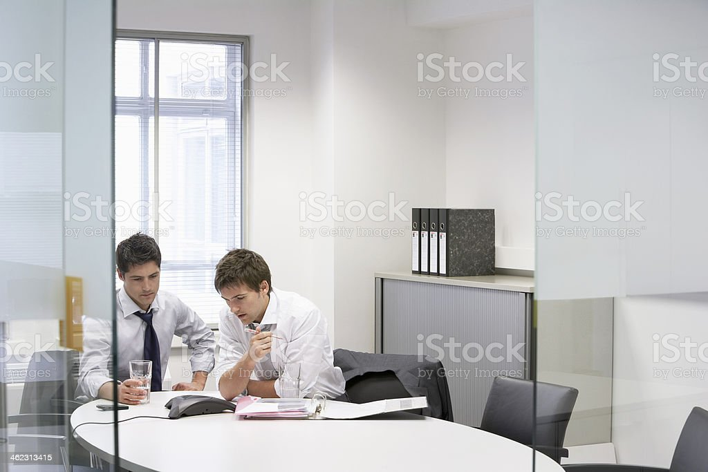 Businessmen Having Conference Call stock photo