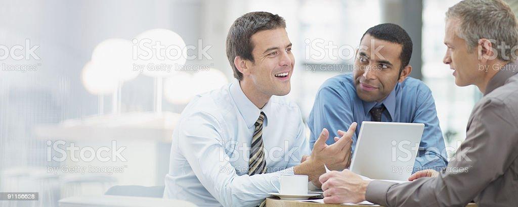 Businessmen having meeting in office stock photo