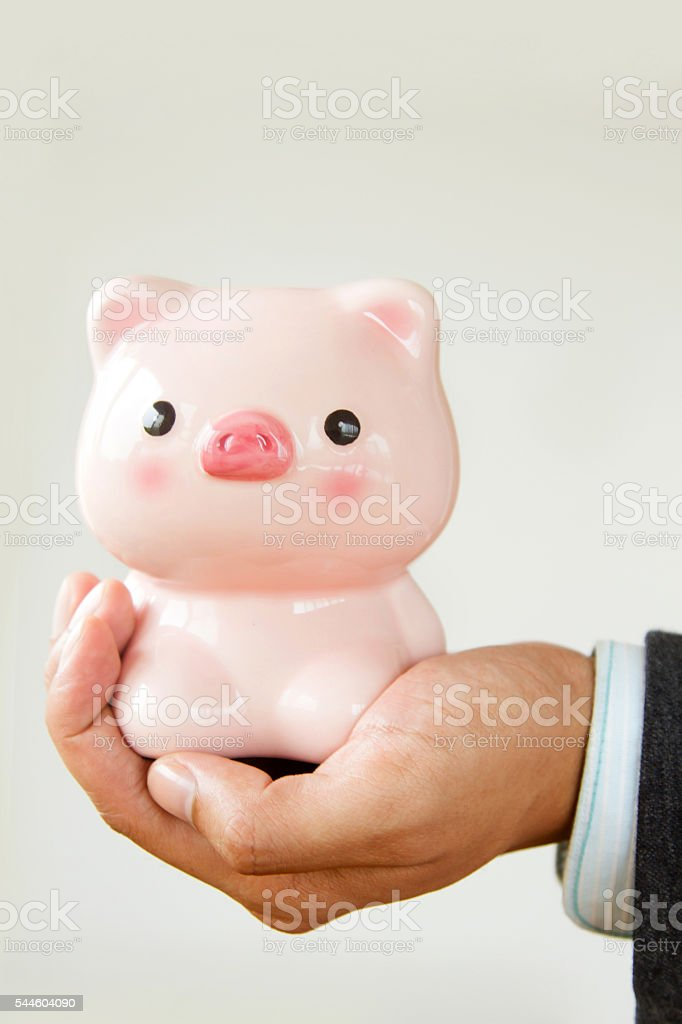 Businessmen holding piggybank stock photo